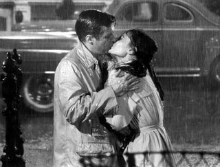 Breakfast at Tiffany's kissing in the rain