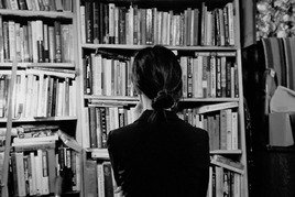 A Girl and a Bookcase